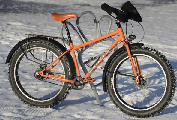 The ultimate winter commuter? Fat tires, internally geared Alfine 11 hub with Gates Carbon Centertrack drive, Alfine front dynamo hub powering a Super Nova E3 headlamp, Hayes Hydraulic disc brakes, Full coverage fenders, and Bar Mitts. What is missing? Dillenger studded tires are still on my wish list.