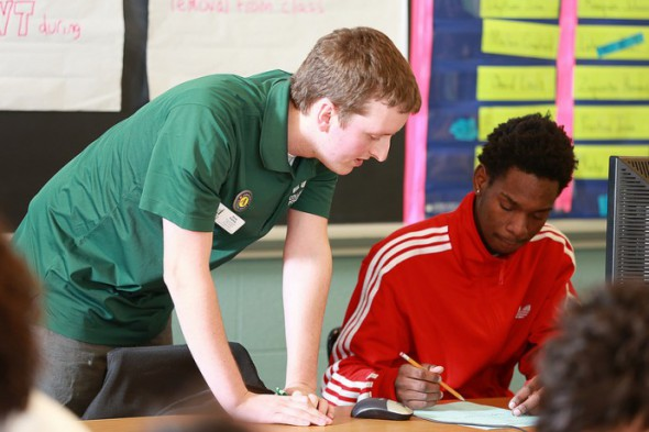 Eric Foley, a College Possible senior coach, works with a student. (Photo courtesy of College Possible)