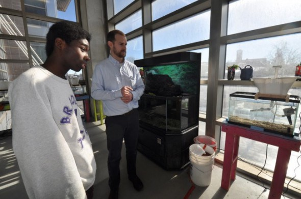 Bradley Tech student Odell Chalmers leads a tour of the Bradley Tech aquaponics classroom and greenhouse. (Photo courtesy of MPS)
