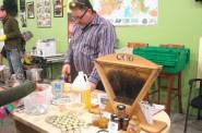 Community member Charlie Koenen measures honey to make homemade lip balm. (Photo by Kelly Meyerhofer)