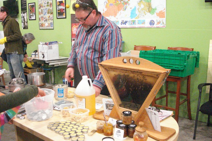Community member Charlie Koenen measures honey to make homemade lip balm. (Photo by Kelly Meyerhofer)