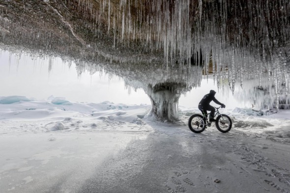 Nick Ginster rides through one of the larger frozen sea caves we found on the eastern shore of Madeline Island.