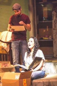 "Rana Roman (with Tommy Rivera-Vega in the background) in a musical highlight from ""In the Heights"" at the Skylight Music Theatre."