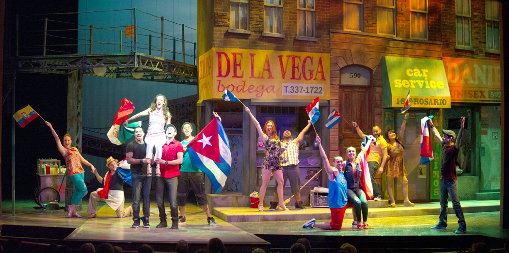 """Sishel Claverie is hoisted aloft by the street ensemble in a festive moment from """"In the Heights."""""""