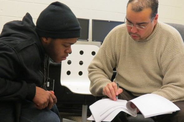 Kavon Jones (left) and Jose Lovo discuss plans for a job training program that will best fit Jones' needs. (Photo by Natalie Wickman)