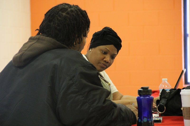 Shanyiell McCloud of Clean Slate Milwaukee checks a man's criminal record to see if he is eligible for expungement during the recent Check Yourself event held at the Park Lawn YMCA. (Photo by Scottie Lee Meyers)