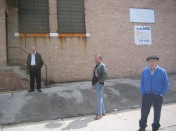 Jimmy Picciurro [l] and his father Peter [r] await a tour of the Old Boys' Club on N. Franklin Pl. Photo by Michael Horne.