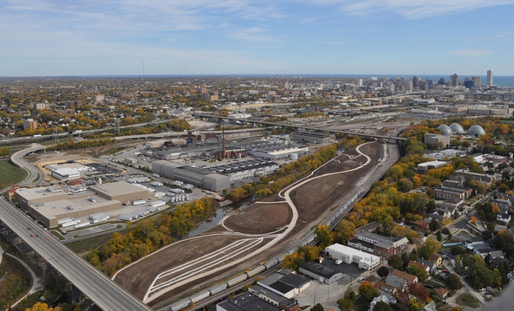 Here is what the Menomonee Valley looked like last summer, filled with new businesses and restored green space. That new Three Bridges Park at the bottom will be green this spring! All this new development on restored brown-fields is springing up in large part due to the trail system and parks. Photo by Milwaukee Dept., of City Development.