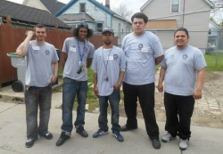 YouthBuild participants give tours of the new house. (Photo by Brittany Carloni)