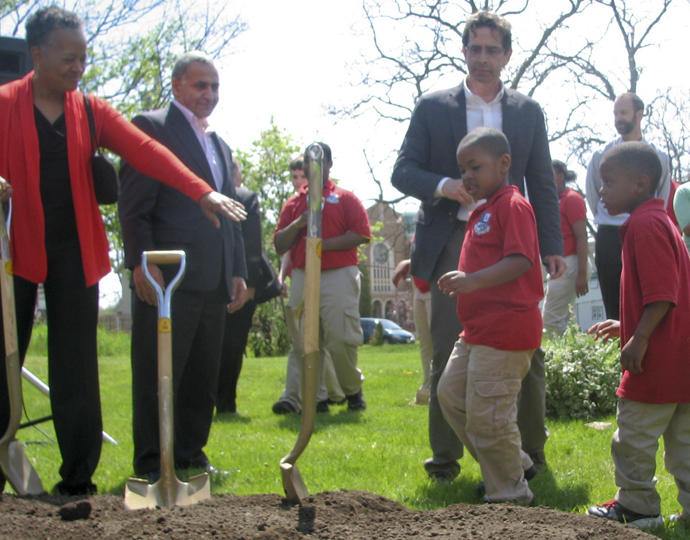 Neighborhood children join Sharon Adams (left) to break ground on a new park at 14th and Wright streets. (Photo by Brendan O'Brien)