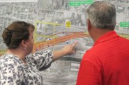 Participants at a forum on continuing development in the Menomonee Valley view a map of the area. (Photo by Scottie Lee Meyers)