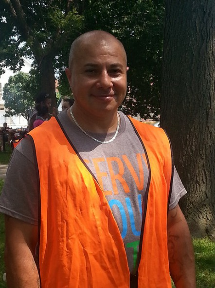 Anthony Mercado, who grew up in Clarke Square, participated in the Clarke Square cleanup. (Photo by Raina J. Johnson)