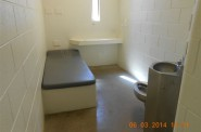 An unoccupied cell in the segregation unit at Waupun Correctional Institution. The cells are small, with a narrow window and concrete and steel furnishings. Photo from the Wisconsin Department of Corrections.