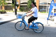 Silvia Tajo, a Fulbright Scholar from Colombia visiting Milwaukee, tests out a Bublr Bike. (Photo By Raina J. Johnson)