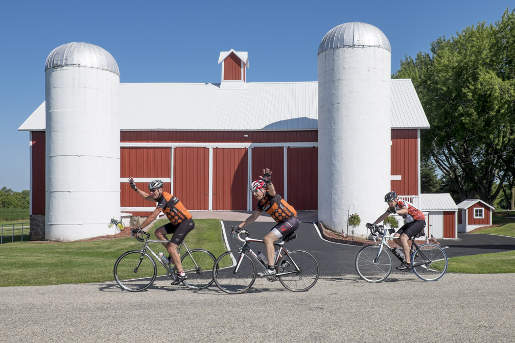 These three guys seem to be having a good day at the office, and you can hardly feel safer than when you are riding with the von Briesen cycling team! (Photo by Dave Schlabowske)