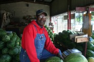 Douglas Moore poses with watermelons at the stand he tends on Sherman Boulevard and Capitol Drive.