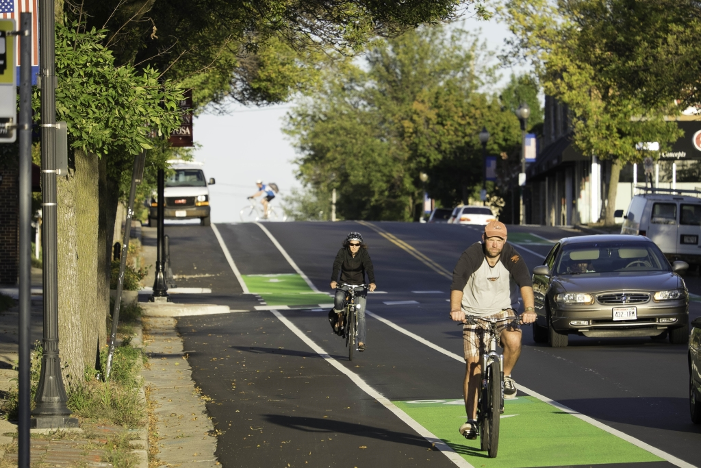 The original curb extensions have been pulled back to allow for the bike lanes.