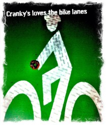 While some cities actually create playful bike people in their bike lane symbols, we have Cranky Al's adding tasty treats to ours!