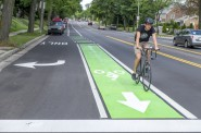 Green pavement markings in bike lanes can be used to highlight conflict points in mixing zones where motor vehicle and bicycle traffic cross.