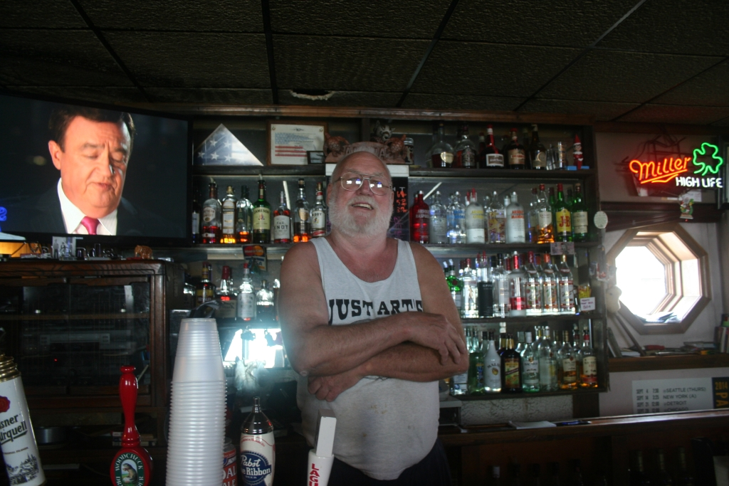 Art Guenther stands behind the bar of Just Art's near 2nd & Pittsburgh in Walker's Point.