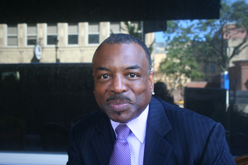 LeVar Burton sits outside the Pfister Hotel near the corner of Mason & Jefferson.
