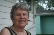 Marilyn Radke sits in front of the house where she's lived for more than 50 years.