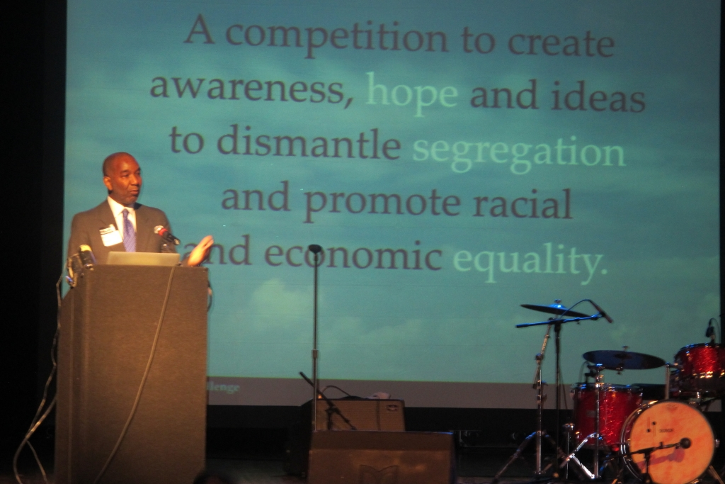 James Hall Jr., president of the Milwaukee branch of the NAACP, addresses the audience. (Photo by Edgar Mendez)