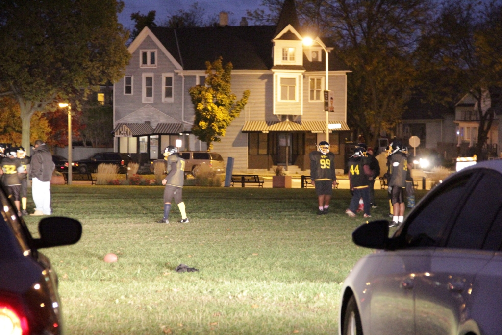 The Running Rebels football team practices at Johnsons Park in the dark. (Photo by Molly Rippinger)