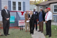 Ribbon-cutting ceremony for NW Impact's first lease-to-own home. Photo by Susan Nusser.