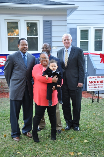 The Liddell-Brooks family is moving in to a new home. Photo by Susan Nusser.