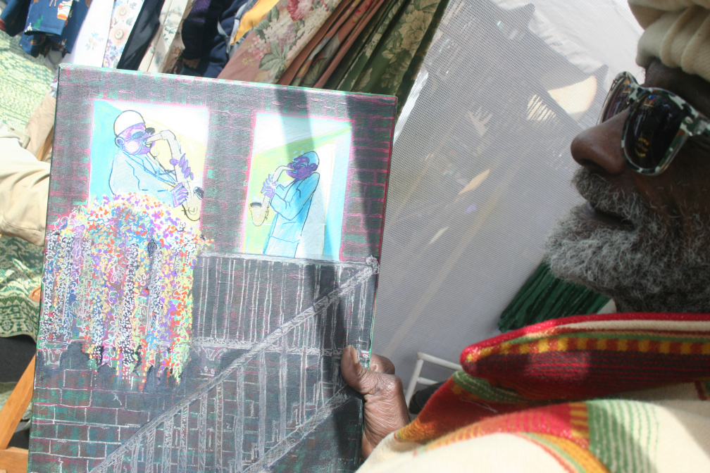 "Bashir Malik displays a piece from his ""grandmother stories"" series."
