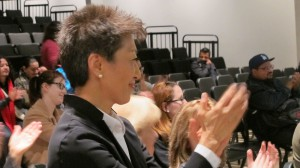 Jane Chu, chairman, National Endowment for the Arts, applauds Latino Strings student performers at the United Community Center. (Photo by Andrea Waxman)