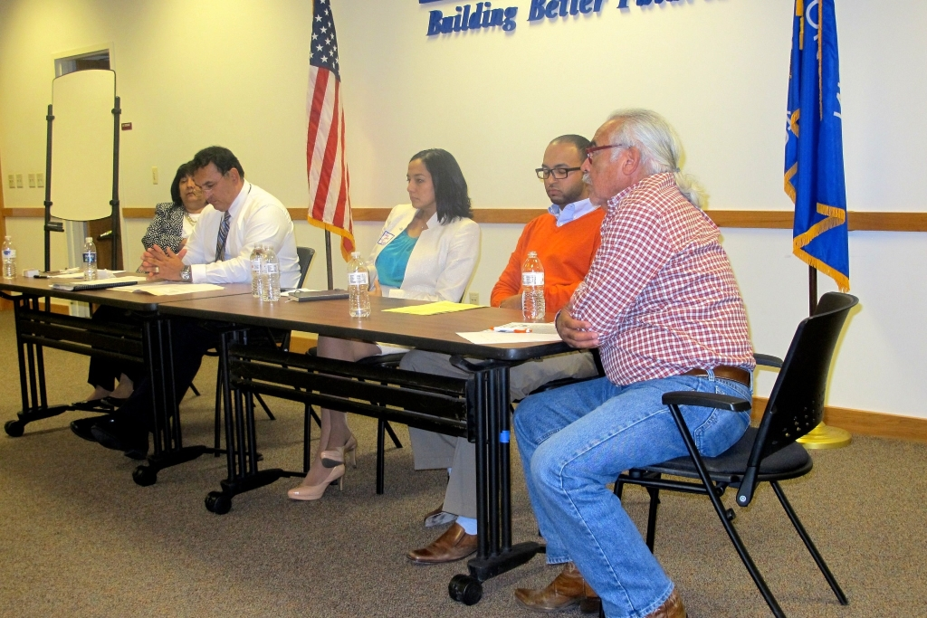 Alumni of the Latino Nonprofit Leadership Program gathered at the UMOS Administrative building for a recent panel discussion. (Photo by Edgar Mendez)