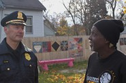 Police Chief Edward Flynn discusses local issues with Harambee resident Darnell Cooper following the award ceremony. (Photo by Matthew Wisla