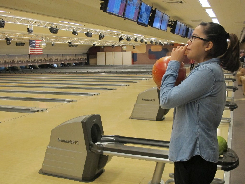 ana loppnow 14 checks the score and gets set to bowl her first frame