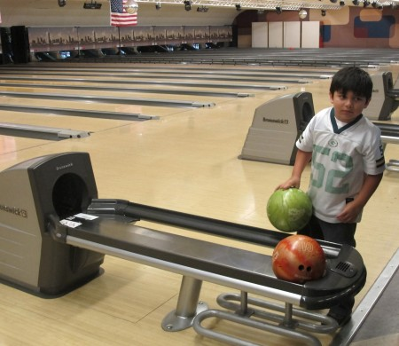 Diego Loppnow, 5, picks up his bowling ball at JB's on 41. (Photo by Teran Powell)