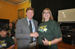 Ms. Milbrath with Green Bay Packers President and CEO Mark Murphy at an event at Greenfield Bilingual School