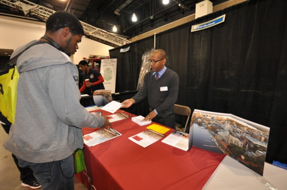 A representative from UW-Madison meets with an MPS student at last year's fair