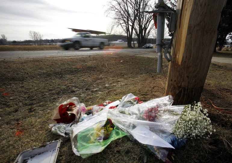 A memorial commemorating the lives of four people killed by a drunken driver sits at the scene of the crash in Fitchburg, Wis.. The driver, Victor Benitez, was sentenced to 32 years in prison. In 2013, there were 4,954 alcohol-related crashes in Wisconsin, leading to 185 deaths and 2,660 injuries. Photo by M.P. King / Wisconsin State Journal.