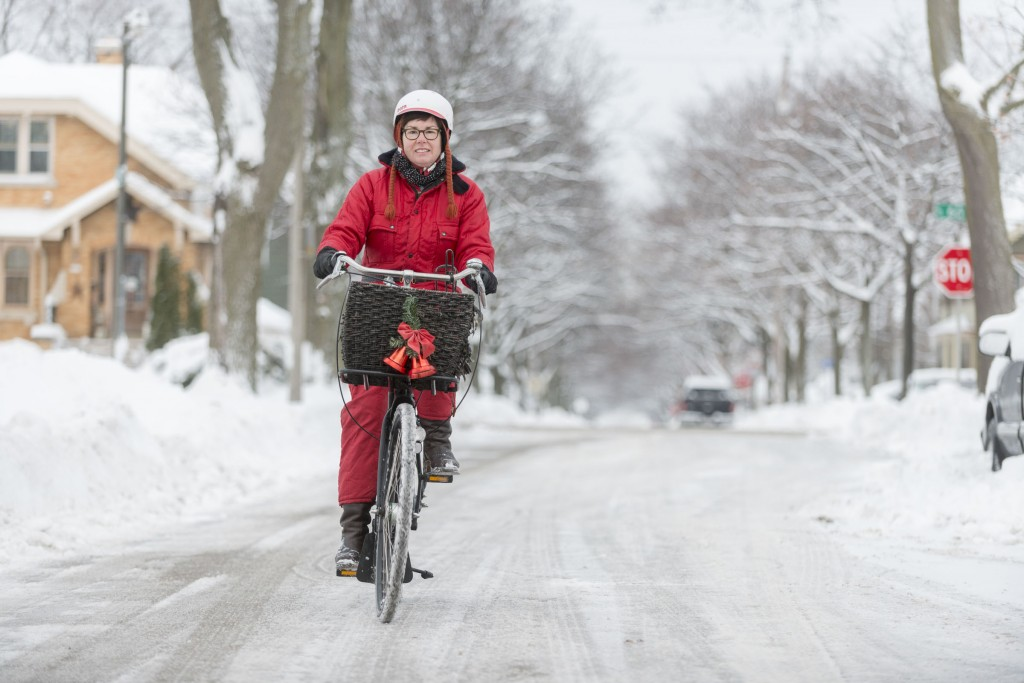 My wife Liz commuting in her cute vintage snowmobile suit last winter on her Dutch Workcycles Omafiets.