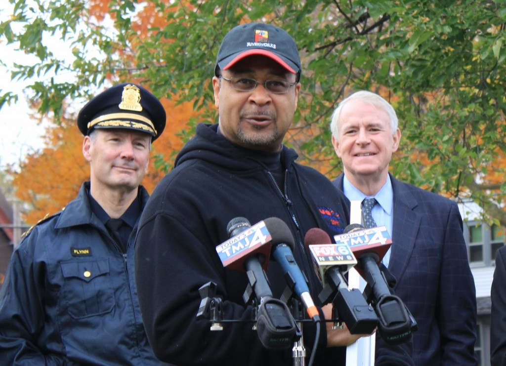 Darryl Johnson, executive director of Riverworks Development Corp., discusses the importance of community-police cooperation to lower crime as Mayor Tom Barrett and Police Chief Edward Flynn look on. (Photo by Matthew Wisla)