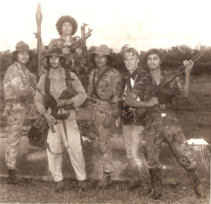 Me and the boys on a patrol up the Rio Escondido in Nicaragua. I did not bother retouching the scratches on this old photo.