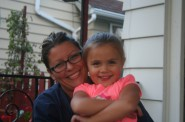 Jennifer Garcia with her youngest, Alexa, in Milwaukee's Morgandale neighborhood.