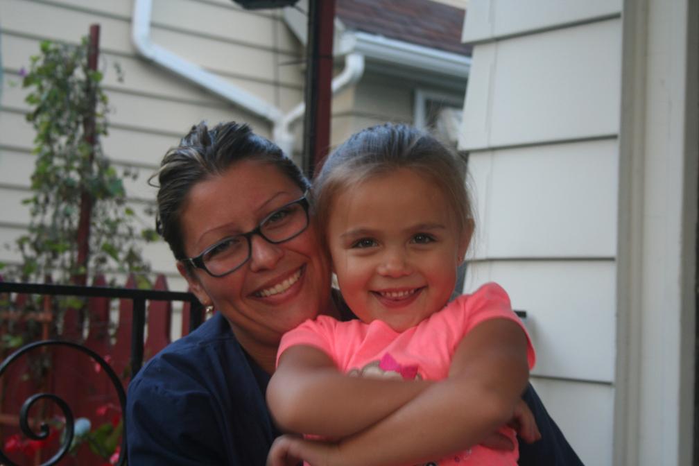 Jennifer Garcia with her youngest, Alexa, in Milwaukee's Morgandale neighborhood.