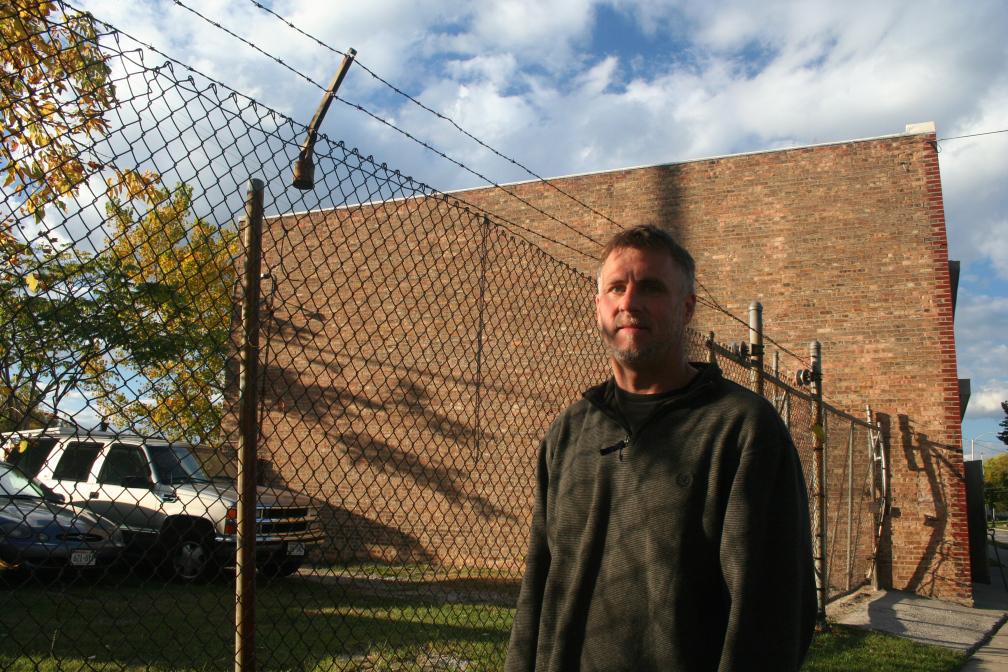 Todd Kubera stands in front of his shop, Schram Auto Body, in Milwaukee's Midtown neighborhood.