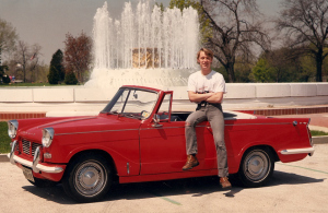 Me and my Triumph Herald photographed by a fountain in a cemetery. I did not see the connection back then.