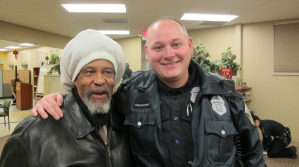 Washington Park resident Don Balentine (left) and Officer Steve Osmanski of the Milwaukee Police Department attended the recent annual gathering at Washington Park Partners. (Photo by Andrea Waxman)