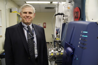 Doug Lewis, president and scientific director of U.S. Drug Testing Laboratories in Des Plaines, Ill., shows a triple quadrupole mass spectrometer, the equipment he uses to find minute traces of alcohol byproducts in fingernails from repeat drunken driving offenders. Photo by Kate Golden / Wisconsin Center for Investigative Journalism.