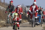 This guy gets the award for the littlest Santa with the biggest heart for scooting along on the ride!