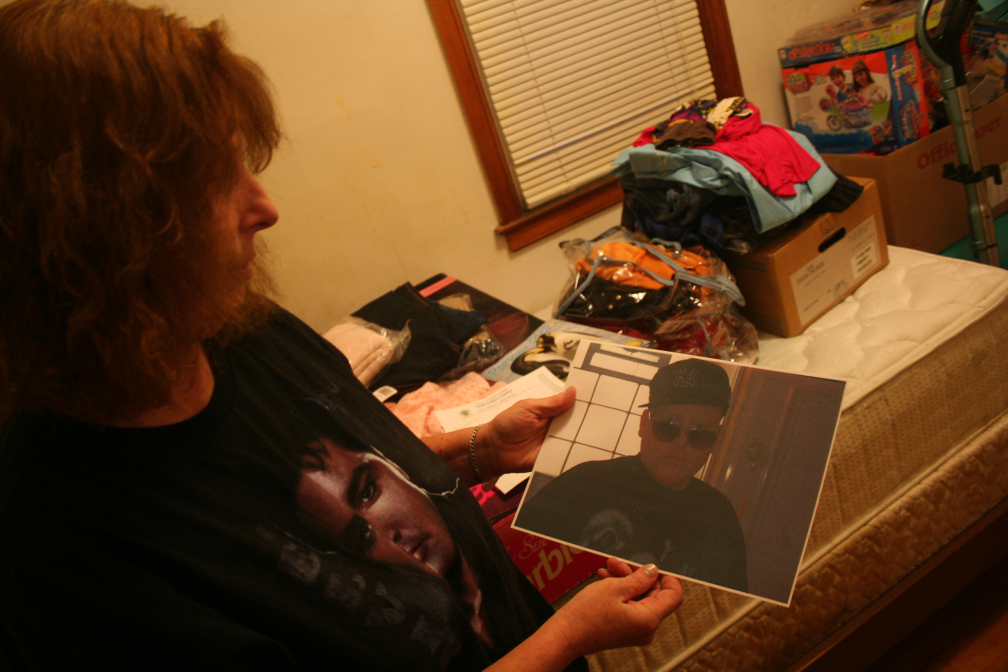 LuAnn Will holds a picture of her son, Joseph Lee Walker, who was shot three times by Milwaukee Police in April.
